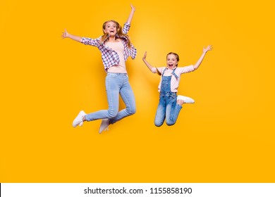 Teen age mom mum mommy  blonde hair legs goal nanny rest relax day summer holidays concept. Full length body size portrait of cheerful joyful sisters making motions in air isolated bright background