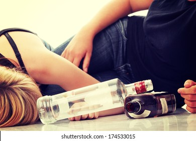 Teen alcohol addiction (drunk teens with vodka and whisky bottle)
