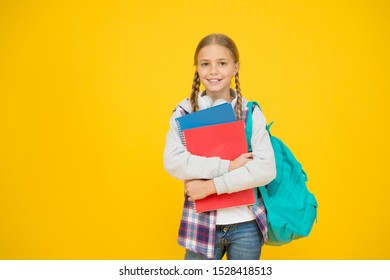 Teen with backpack and books. Motivated and diligent. Stylish schoolgirl. Girl little fashionable schoolgirl carry backpack. Schoolgirl daily life. School club. Modern education. Private schooling.