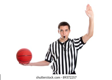 Teen basketball referee giving sign for inbound pass