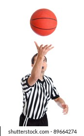 Teen basketball referee throwing ball in the air isolated on white