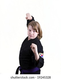 "A teen in a black Karate uniform ready in ""Double Block"" stance."