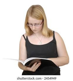 Teen blond girl reading book