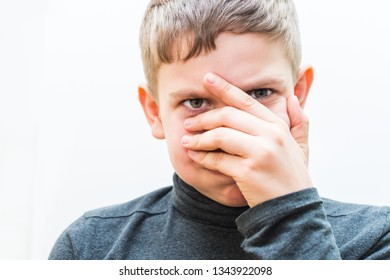 teen boy in aggressive expression