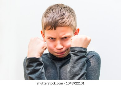 teen boy is angry. portrait on white isolated background