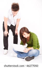 Teen boy and  brownl girl with white laptop
