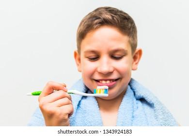 teen boy brushing his teeth