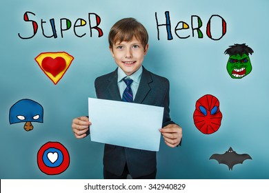 Teen boy businessman holding a piece of paper and laughs superhero super power at the photo studio Icons hero