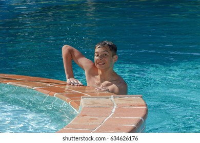 Teen boy dives and swims in the pool on a summer day rest