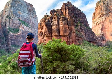 Teen boy hiking through scenic canyons at Zion National Park. Exploring the beauty of the Narrows and the beautiful canyons of southern Utah