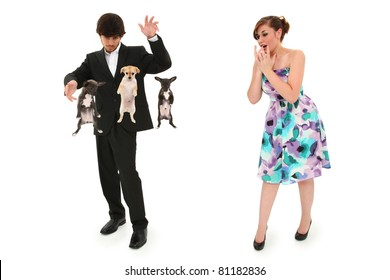 Teen boy impressing date by levitating puppies with magic.  Clipping path over white background.