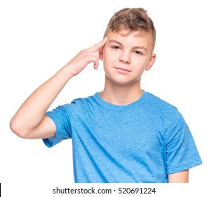 Teen boy making an imaginary gun shoot. Emotional portrait of bored teenager committing suicide with finger gun gesture. Child shooting hisself making finger pistol sign,  isolated on white background