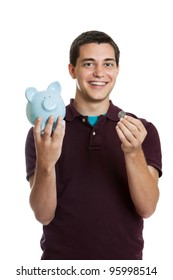 Teen boy with piggy bank saving for college isolated on a white background