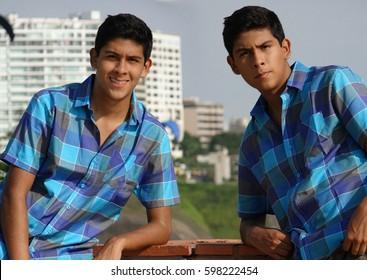 Teen Boy Posing As Twin Brothers