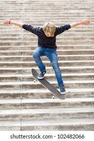 teen boy skateboarding on stairs