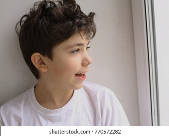 teen boy smiling facial profile half face portrait close up photo on window background