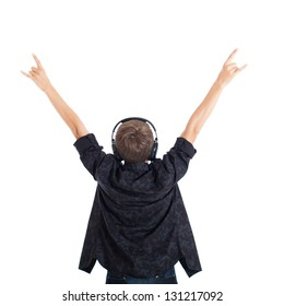 Teen boy wearing a black shirt with headphones. The boy raised his hands. Rock fan. View from the back. Studio shot, isolated on white background.