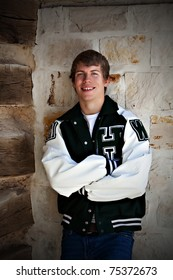 Teen boy wearing letter jacket.