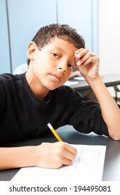 Teen boy worried about taking a standardized test.