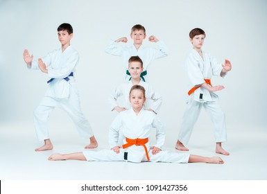 6e0d57b302f67 The teen boys and girl fighting at Aikido training in martial arts school. Healthy  lifestyle