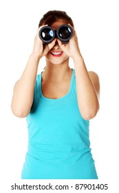 Teen caucasian student smiling and looking through binoculars. Isolated on white background