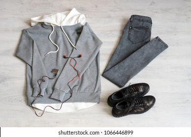 Teen clothing set: grey sweatshirt, black jeans and boots in military style