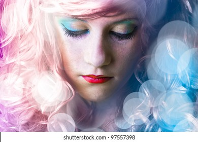 Teen with colored hair, light effects in disco