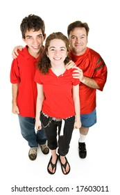 Teen couple and the girls father dressed in red, supporting their favorite sports team.  Full body isolated on white.