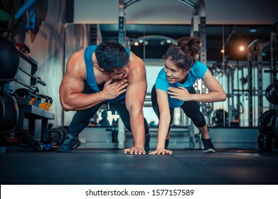 Teen couples exercise in the gym