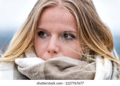 Teen covered with a scarf
