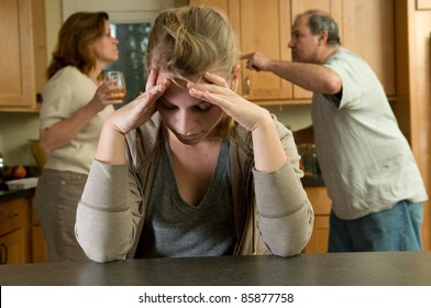 Teen daughter struggles while parents fight behind her