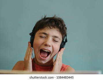 teen dj boy listening to favourite rock group track singing along close up photo