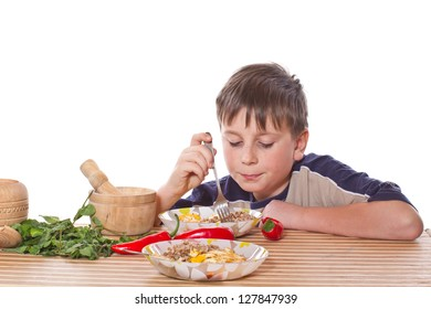 Teen eats healthy food on a white background