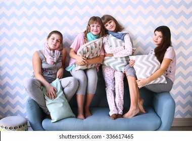 teen four girls on pajama party with pillows
