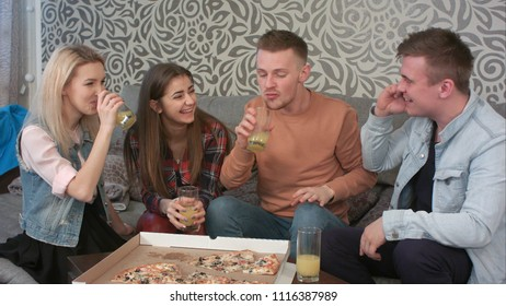 Teen friends sitting on the sofa and calling someone, they are really happy to hear