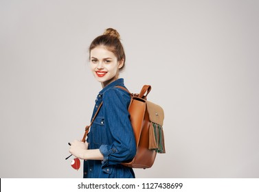teen girl with backpack smiling