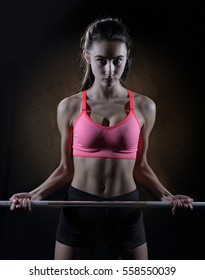 Teen girl with barbell