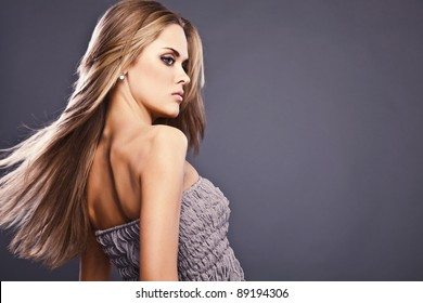 Teen girl beautiful cheerful enjoying on gray background