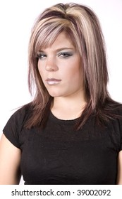 A teen girl in black expressing her anger by showing her mean look.