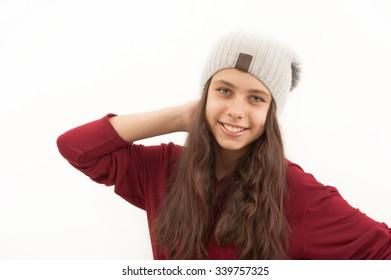 Teen girl in a cap