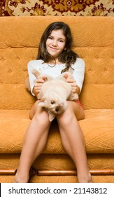 Teen girl with cat on the sofa