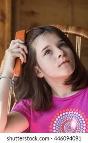 Teen girl combing her hair