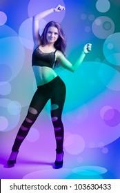 Teen girl dancing in a disco