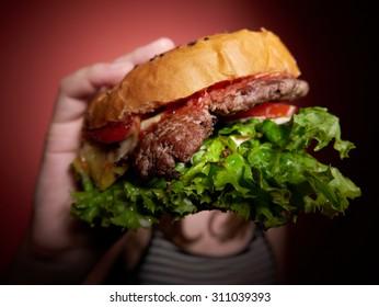 Teen girl with a delicious burger