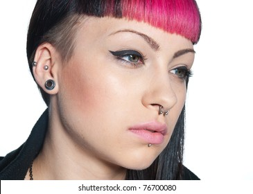 teen girl with face nose and ear piercings