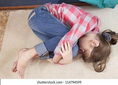 Teen girl frustration crying lying on the floor