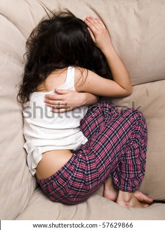 Teen girl frustration crying lying in chair