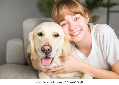 A Teen Girl with her golden retreiver dog