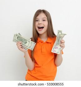 teen girl holding dollars