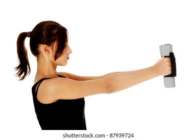 Teen girl holding dumbbells and doing exercises. Isolated on white
